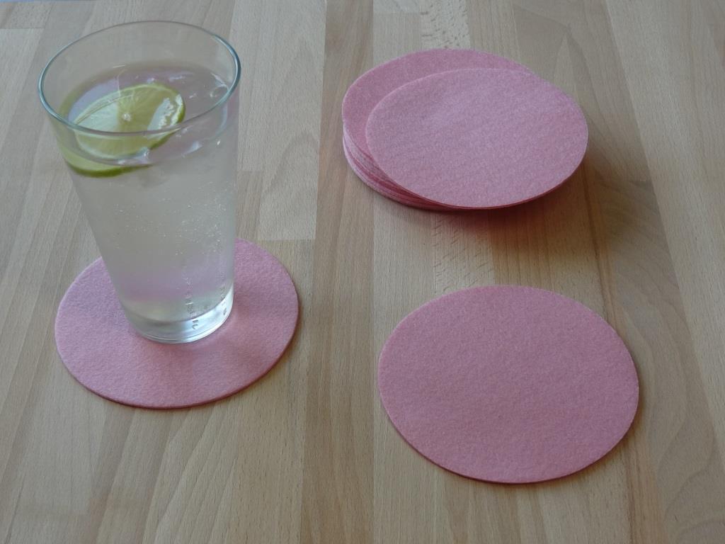 Nonwoven Coaster, set of 12, diameter = 11.2 cm, pink