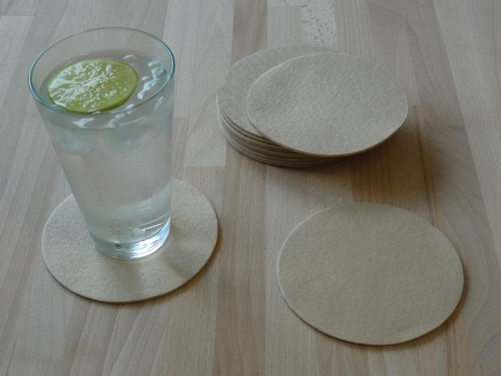 Placemats round in a set of 8 with matching round glass coasters, beige